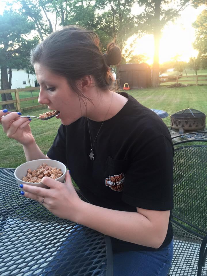 Hannah eating Tiny Toast