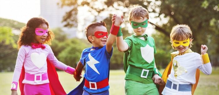 kids playing super heroes